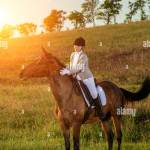 Young Woman Rider With Her Horse In Evening Sunset Light Outdoor Photography In Lifestyle Mood Equestrianism Horse Riding Horse Racing Rider On A Stock Photo Alamy