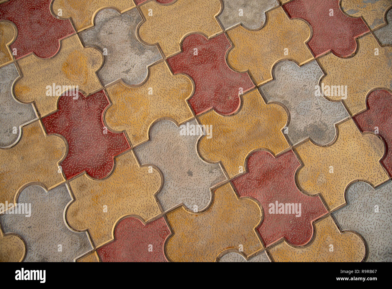https www alamy com jigsaw floor tiles each vibrant floor tile fitting together like a puzzle piece oxford shape image229780383 html