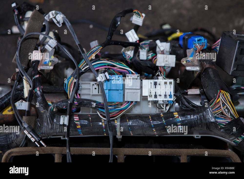 medium resolution of repair the car wiring a large tangle of ravel multicolored wires from the car wiring lies in the cabin of the dismantled car with connectors and plu