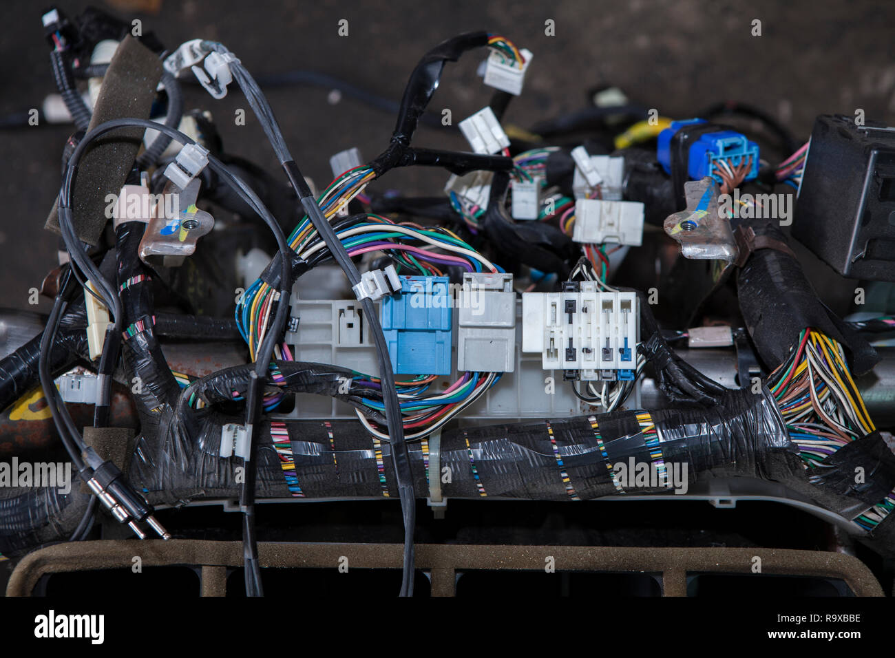 hight resolution of repair the car wiring a large tangle of ravel multicolored wires from the car wiring lies in the cabin of the dismantled car with connectors and plu