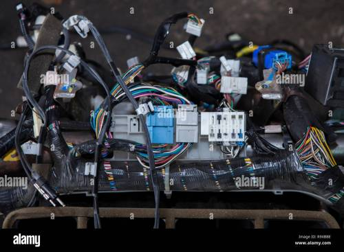 small resolution of repair the car wiring a large tangle of ravel multicolored wires from the car wiring lies in the cabin of the dismantled car with connectors and plu