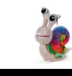 crochet rainbow snail with eyes on white background amigurumi handmade stock image [ 1300 x 956 Pixel ]
