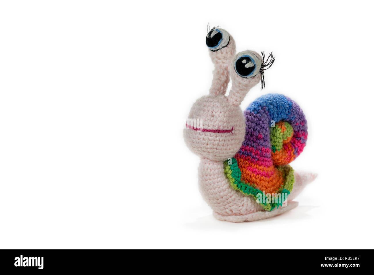 hight resolution of crochet rainbow snail with eyes on white background amigurumi handmade stock image