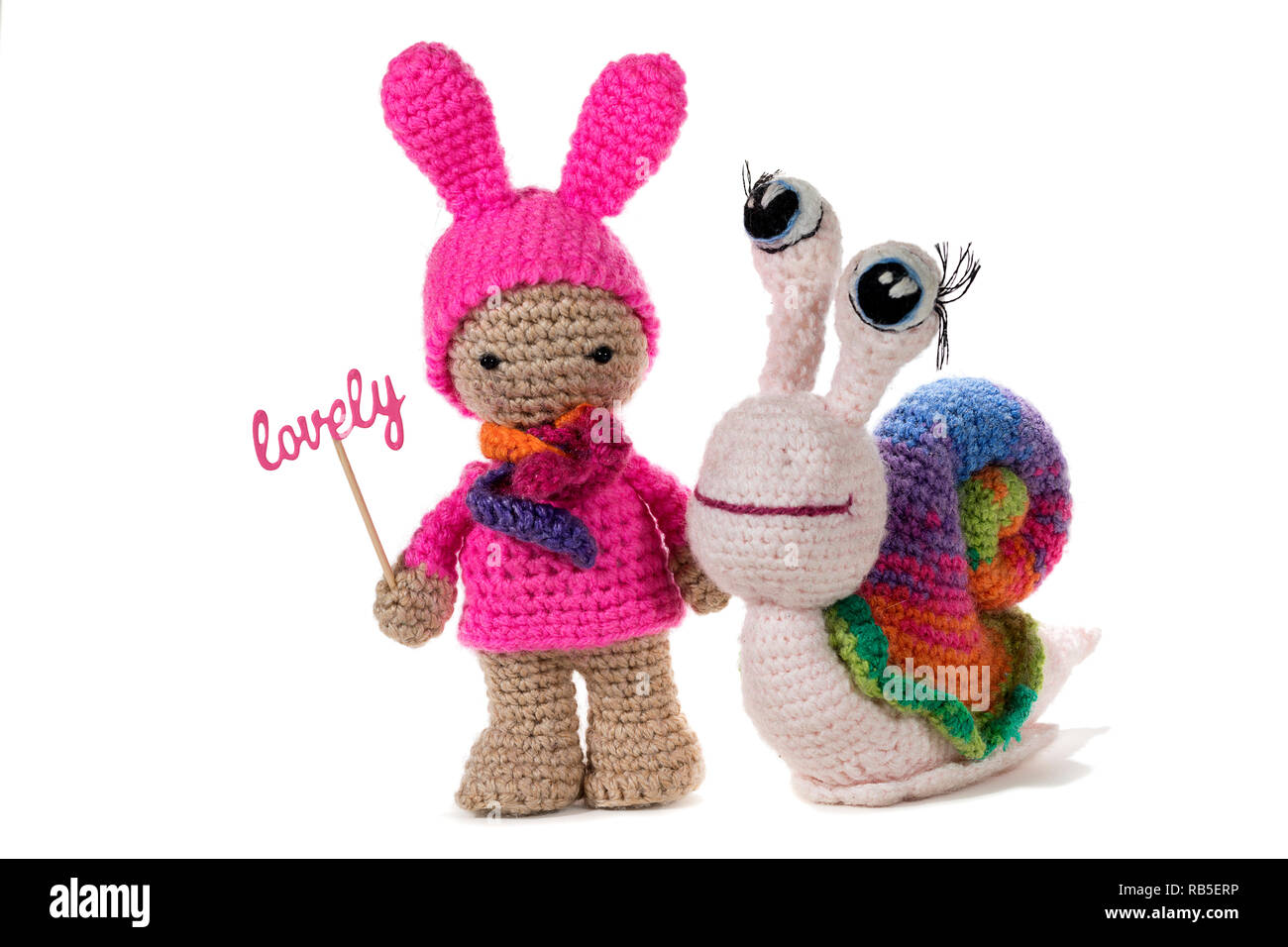 hight resolution of crochet girl holding sign lovely and crochet rainbow snail on white background amigurumi