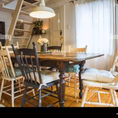 Cottage Style Chairs Best Gaming Chair For Adults Antique Wooden Dining Table With Assorted Coloured Inside An Old 1862 Home
