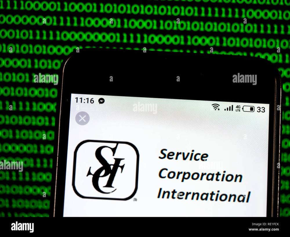 medium resolution of service corporation international funeral home company logo seen displayed on smart phone