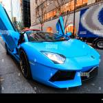 Light Blue Lamborghini Aventador Roadster High Performance Super Car With Doors Open Parked In The Ginza Famous Shopping Street In Tokyo Stock Photo Alamy