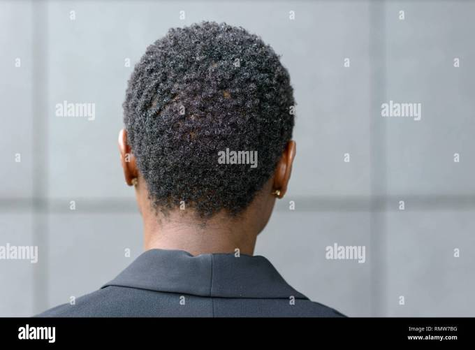 close up backview portrait of young black woman with short
