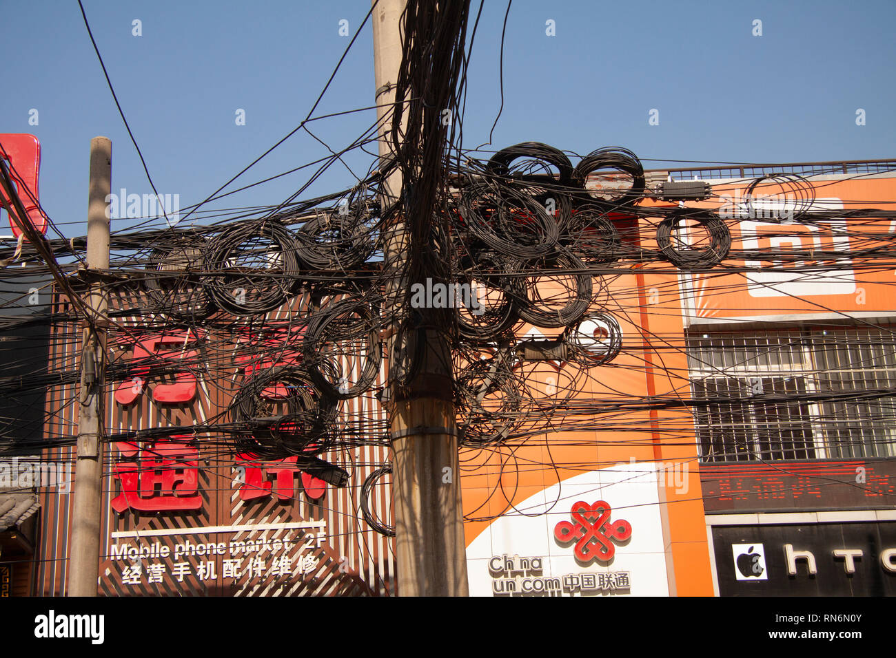 hight resolution of messy tangle of electric and telephone wires on street pole shanghai china december 29 2014