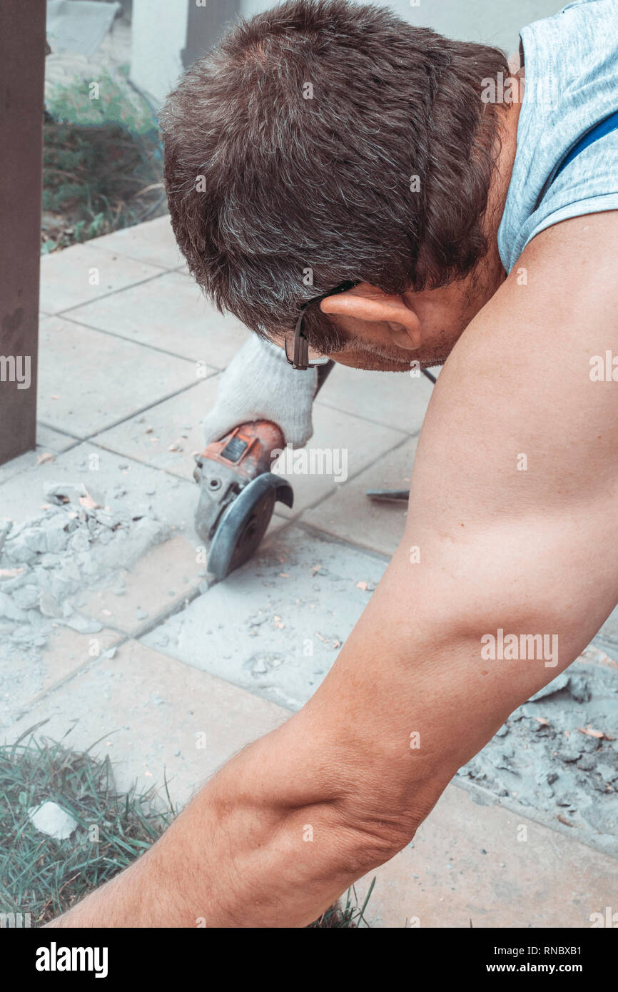 https www alamy com man cut angle grinder concrete in action dust while grinding tiles image236904725 html