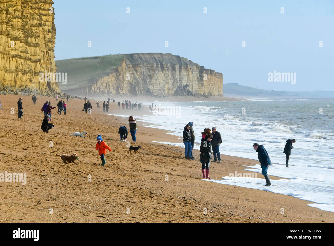 West Bay Dorset Uk 19th February 2019 Uk Weather Visitors Flock To The Beach At West