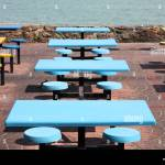 Plastic Tables And Chairs In A Seaside Outdoor Restaurant In