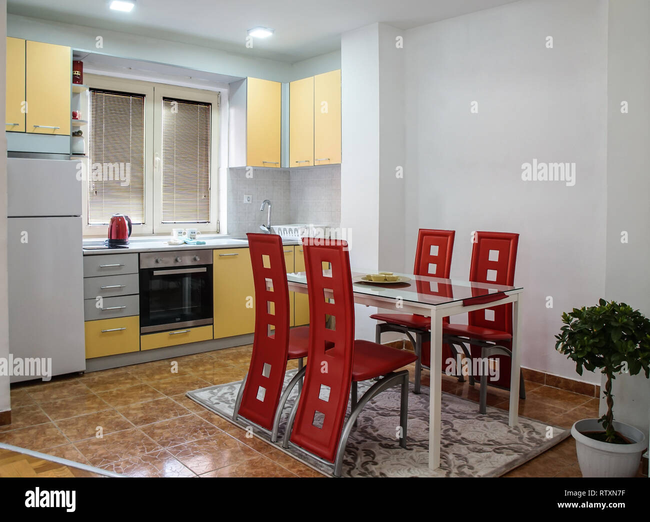 Modern Kitchen Chairs Modern Kitchen With Dining Area With Nice Red Leather Chairs Stock