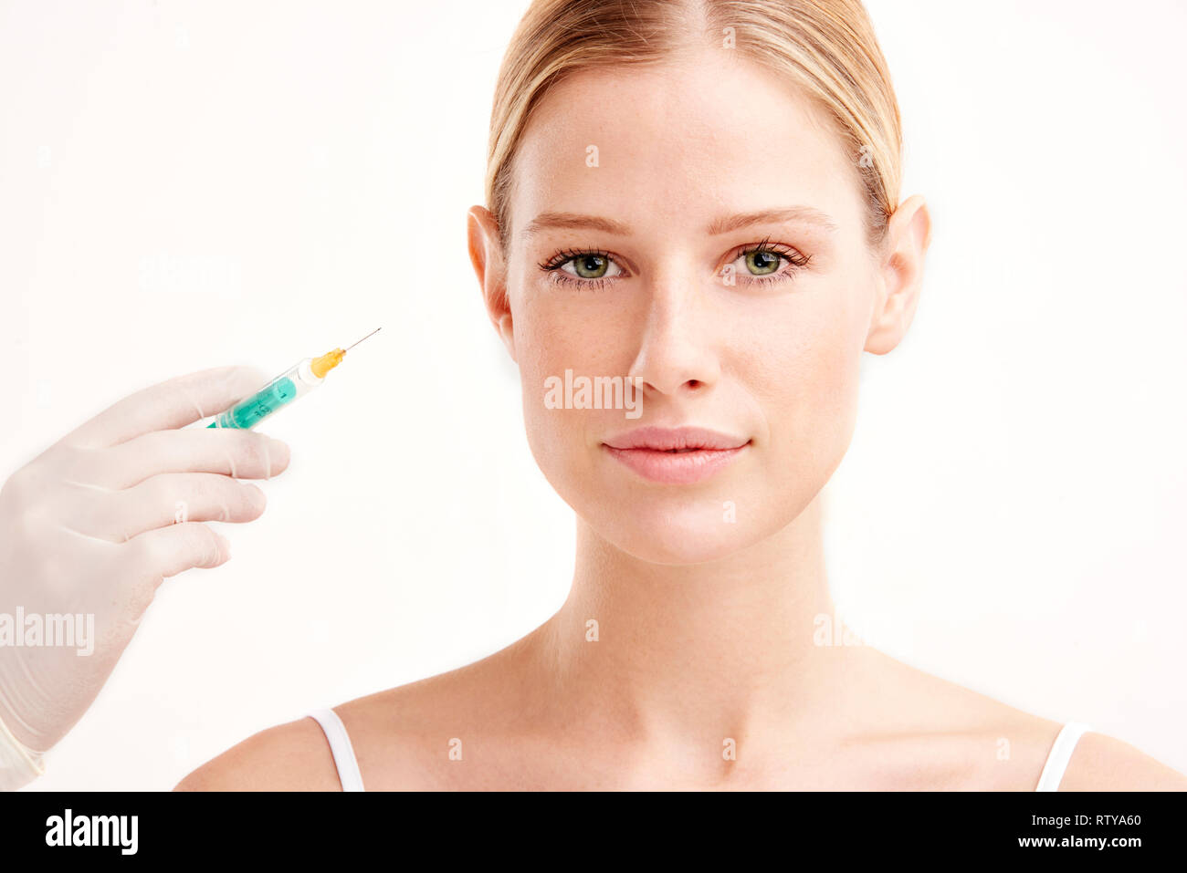 hight resolution of close up portrait shot of beautiful young woman having botox on her face isolated