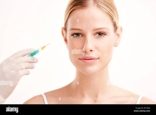small resolution of close up portrait shot of beautiful young woman having botox on her face isolated