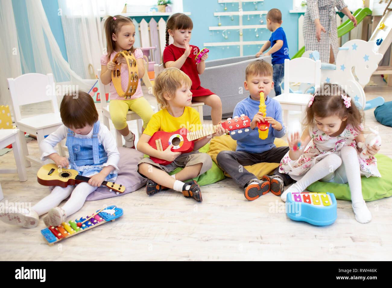 Kids Learning Musical Instruments On Lesson In