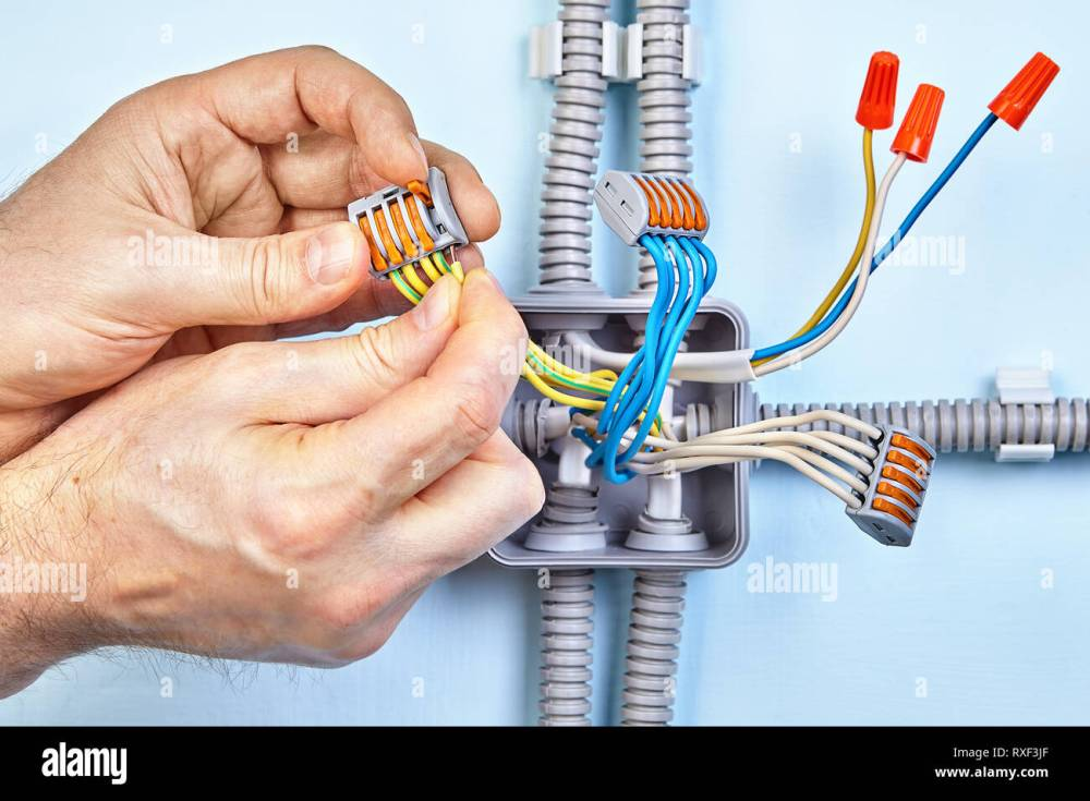 medium resolution of electrician is making new junction box for electrical wires with help of push wire connectors and closed end crimp caps on copper wiring