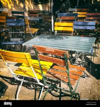 Colourful painted wooden outdoor table and chairs Stock ...