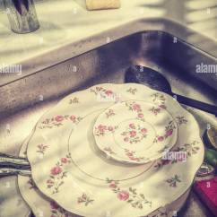 Kitchen China Dishes Pot Hangers Dirty In Residential Sink Usa Stock Photo