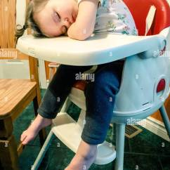 Chair For Toddler Girl Faux Leather Repair Kit Asleep In Her High At Dinner Stock Photo