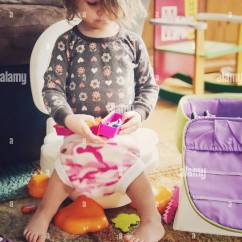 Chair For Toddler Girl And Trellis 2 Year Old Sitting On Potty Playing With Toys While Toilet Training