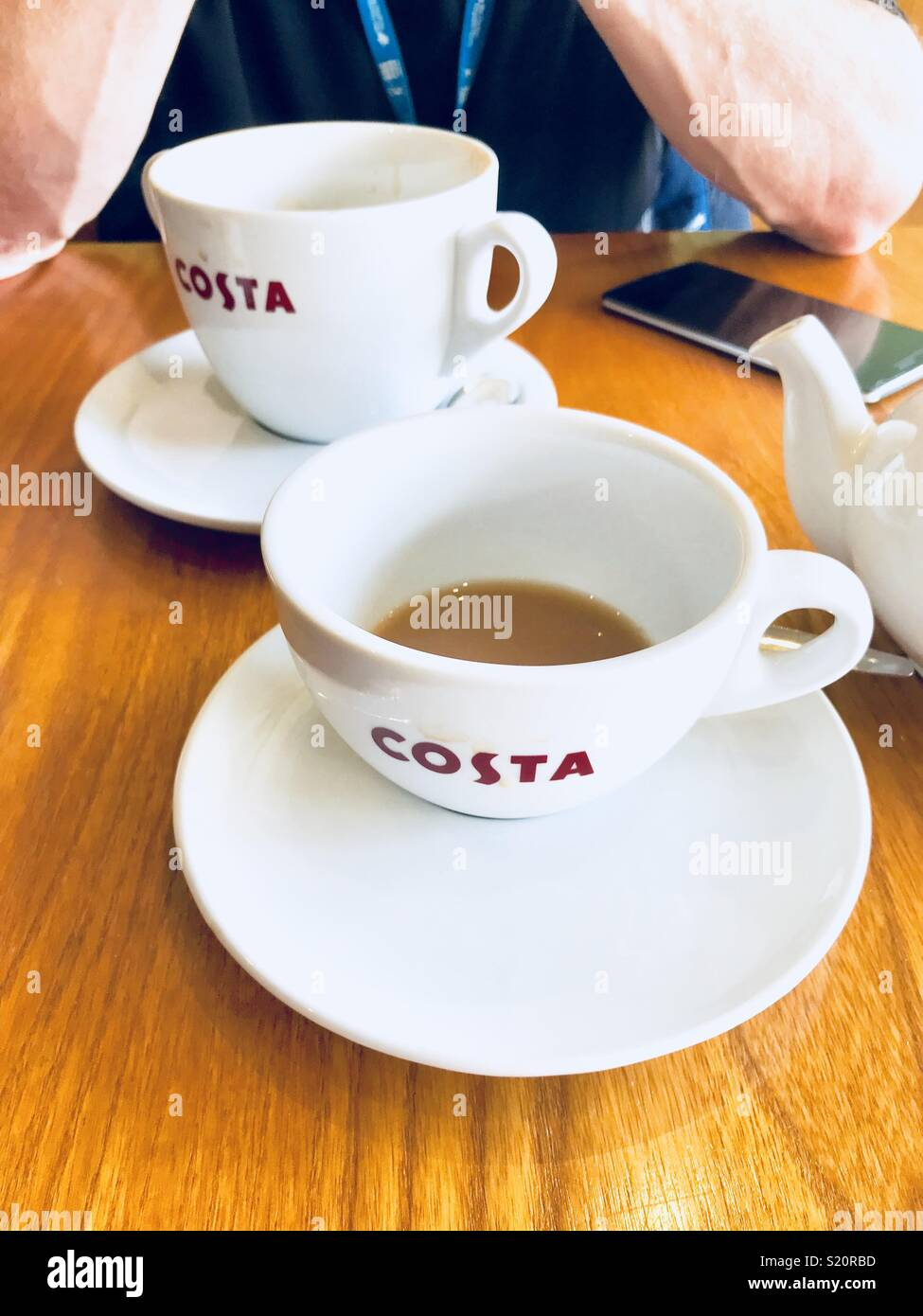 drinking costa coffee stock