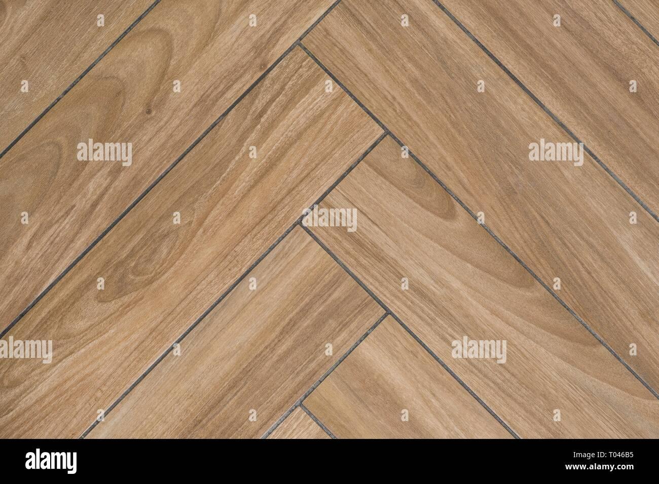 https www alamy com oak wood texture of floor with tiles immitating hardwood flooring traditional herringbone pattern image241037977 html