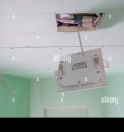 the white wires inside the ceiling with the white box hanging on the square hole of [ 1300 x 821 Pixel ]