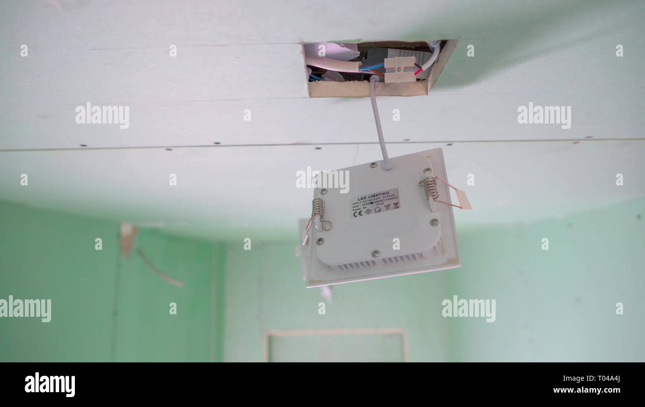 hight resolution of the white wires inside the ceiling with the white box hanging on the square hole of