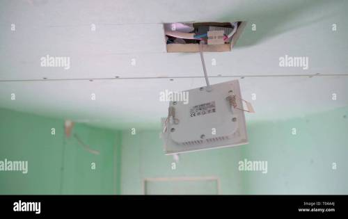 small resolution of the white wires inside the ceiling with the white box hanging on the square hole of