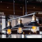 Black Iron Loft Chandeliers With Edison Lamps On A Black Background Bokeh Concept Of Modern Interior Design Of A Restaurant Cafe Apartment Office Stock Photo Alamy