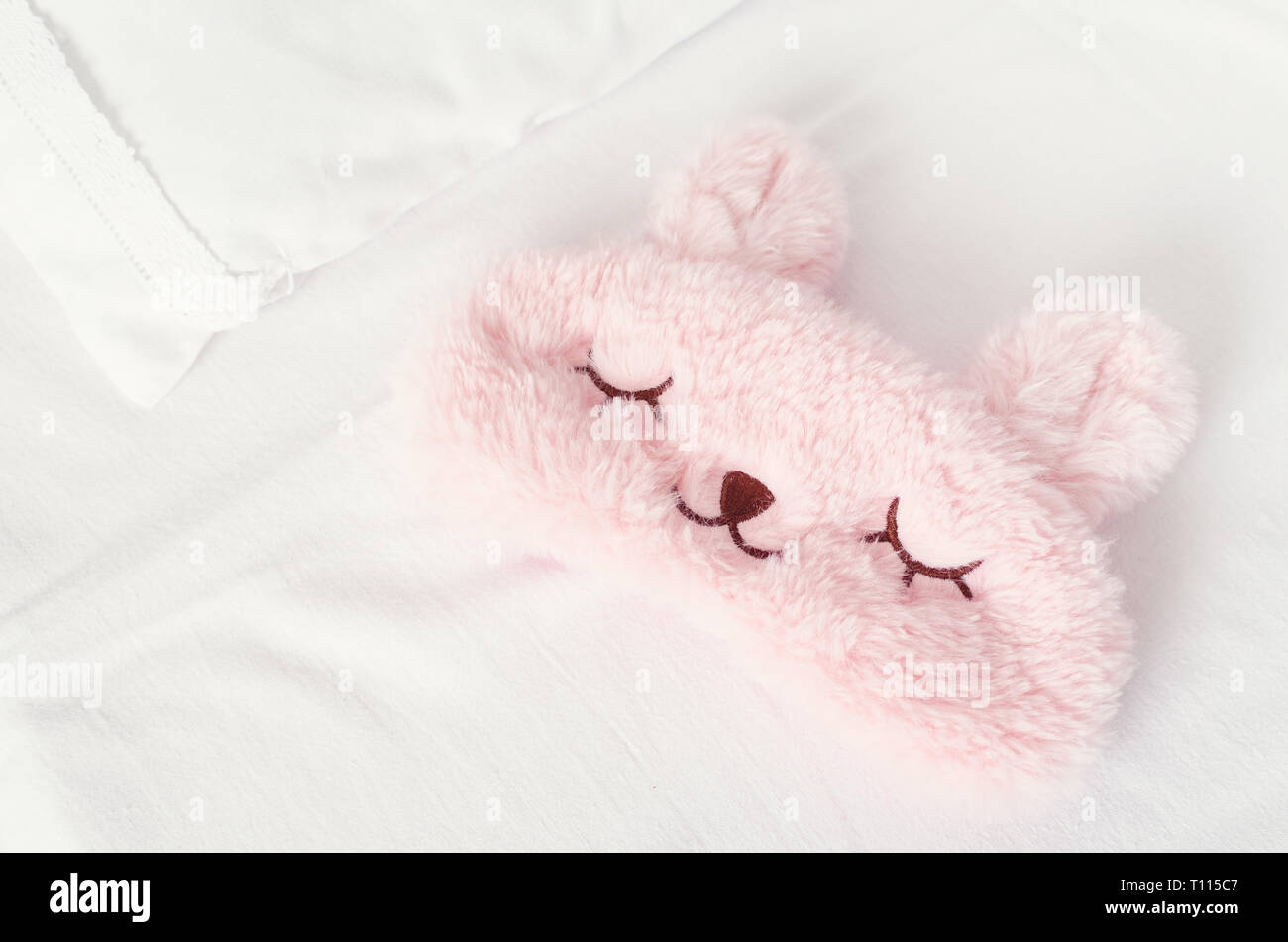 https www alamy com white bedding sheet blanket and pillows with cute pink sleep mask on the bed rest sleeping comfort concept top view image241586023 html