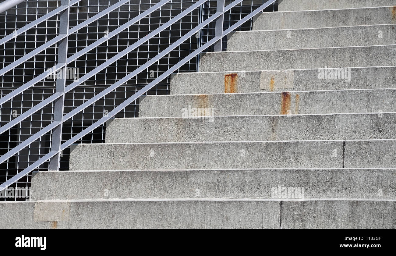 Steel Railing At An Outdoor Stairway With Cement Steps Seen From   Outdoor Handrails For Concrete Steps   Contemporary   Hand Rail   Precast   Stair   Water Pipe