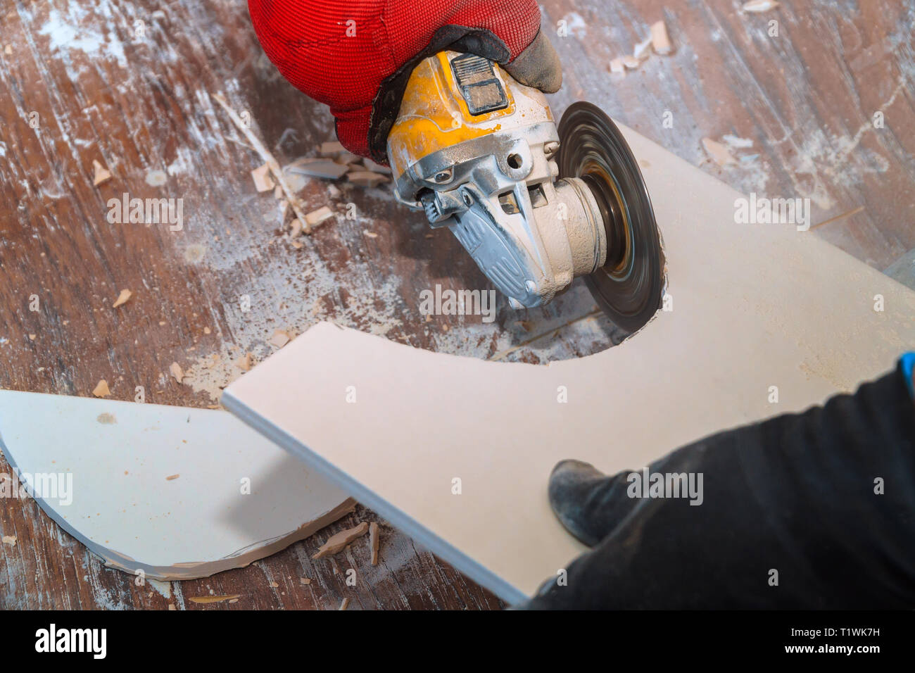 https www alamy com worker hand cutting ceramic floor paving tile with electric angle grinder image242123717 html