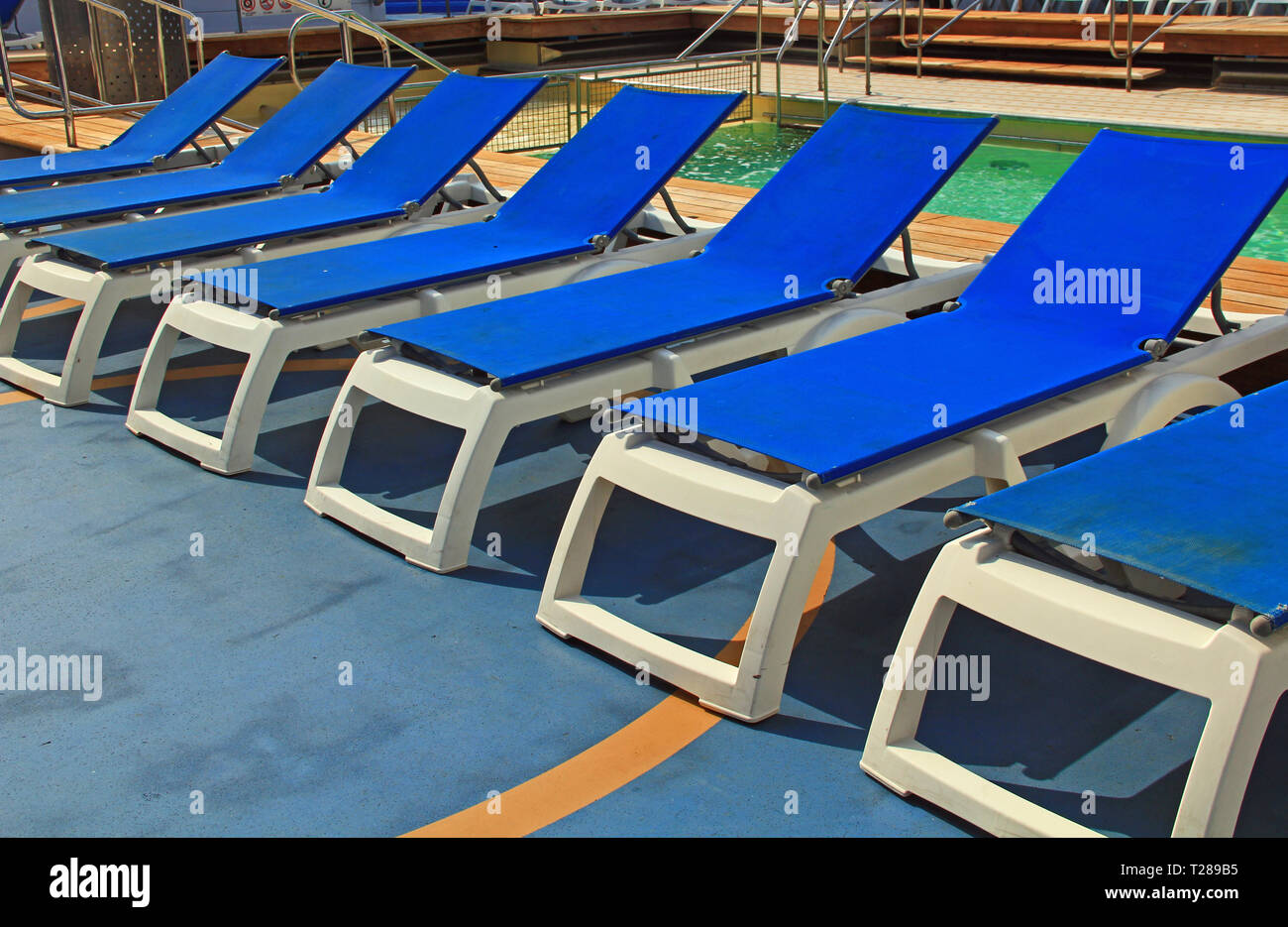 Chairs For Pool Blue Pool Deck Chairs On A Cruise Ship Stock Photo 242357449 Alamy