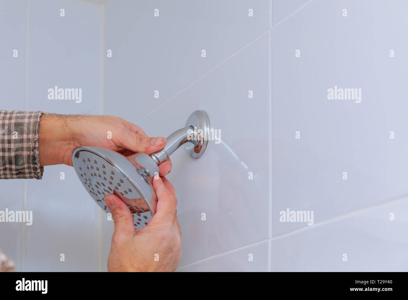 Workman Repairing Shower Head The Plumbing In The Bathroom