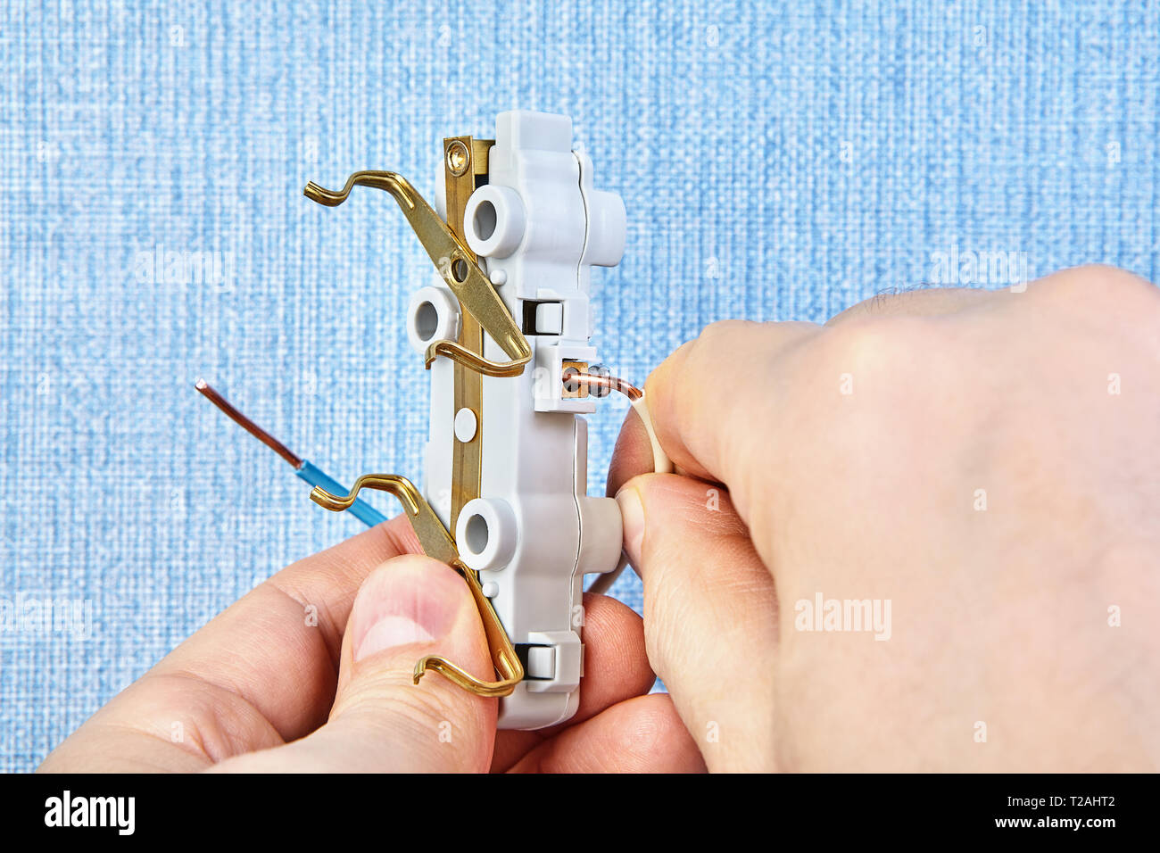 hight resolution of worker is installing electric plug house wiring close up stock image