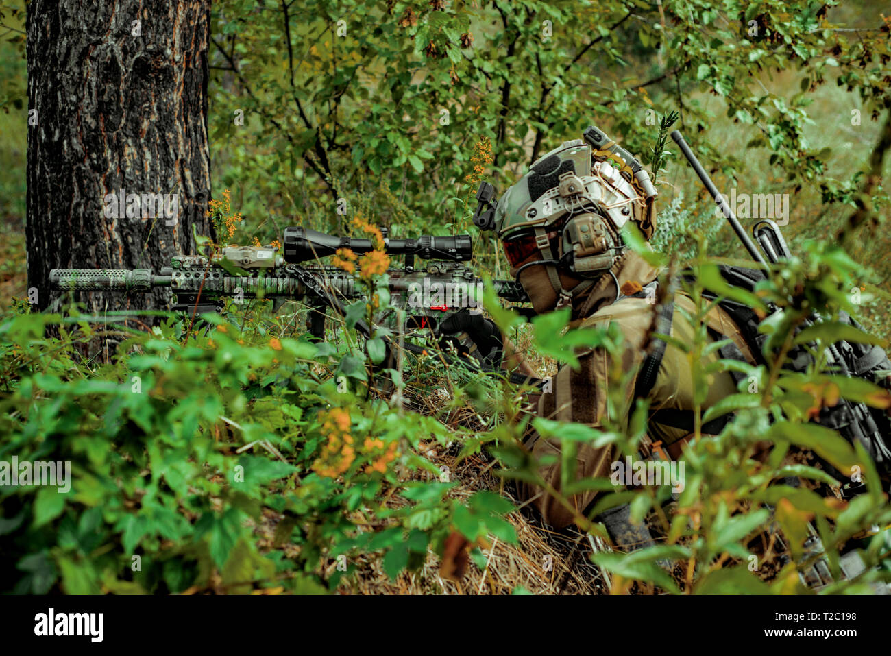 hight resolution of airsoft man with optical sight gun soldier lay on hill in the forest