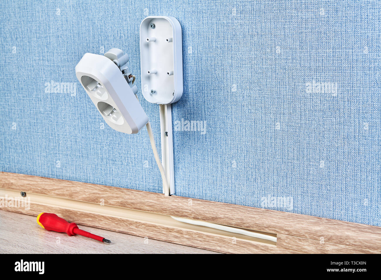 hight resolution of duplex receptacle outlet in process of mounting residential wiring work close up