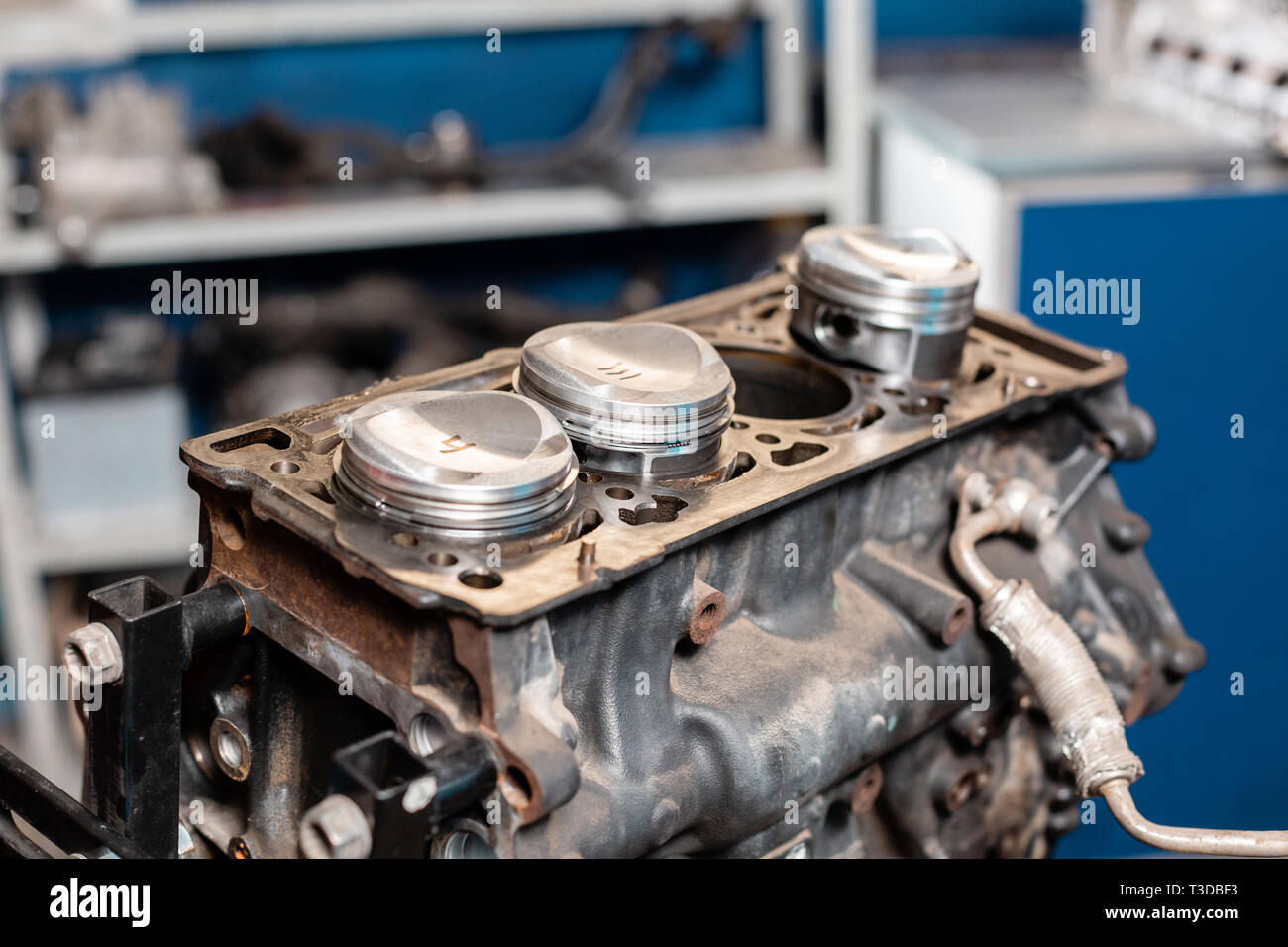 hight resolution of close up a new pistons for the engine overhaul engine on a repair stand with piston and connecting rod of automotive technology interior of a car