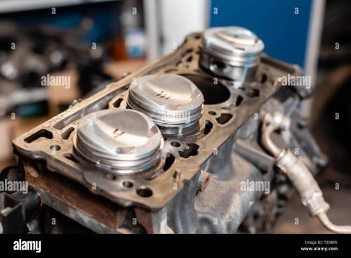 small resolution of close up a new pistons for the engine overhaul engine on a repair stand with piston and connecting rod of automotive technology interior of a car