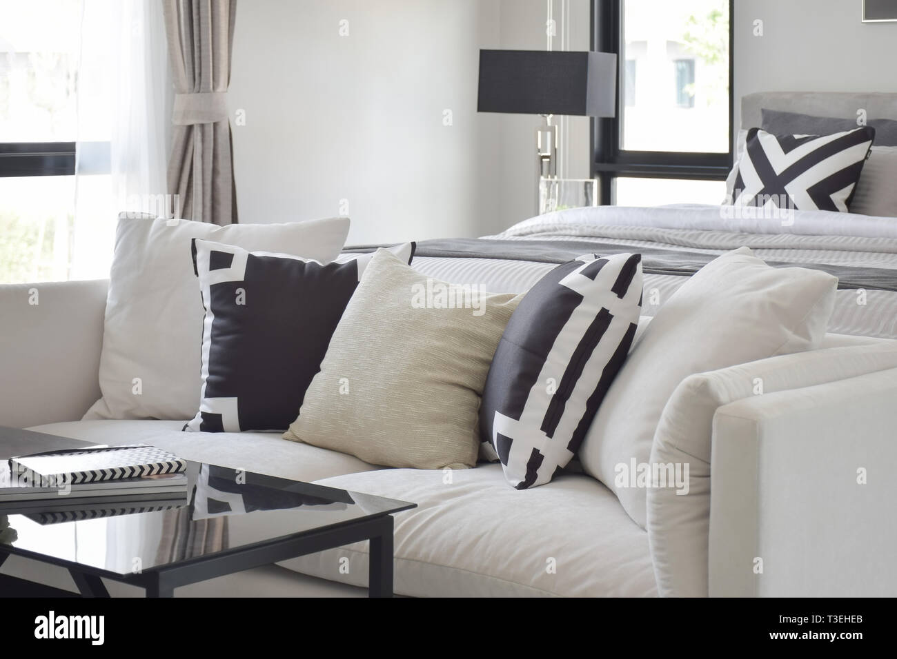 https www alamy com black and white graphic printed pillow on off white sofa next to bed image243110179 html
