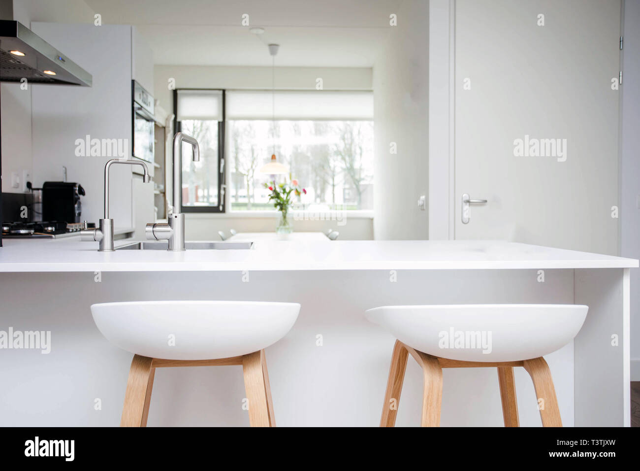 Bar Stools By Modern White Kitchen Island New And Clean Modern Design Stock Photo Alamy