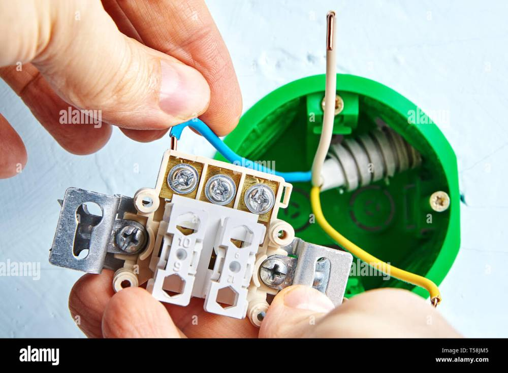 medium resolution of installation of new double light switch connecting to round outlet box for wall light electric installation work two button switch placed in the so