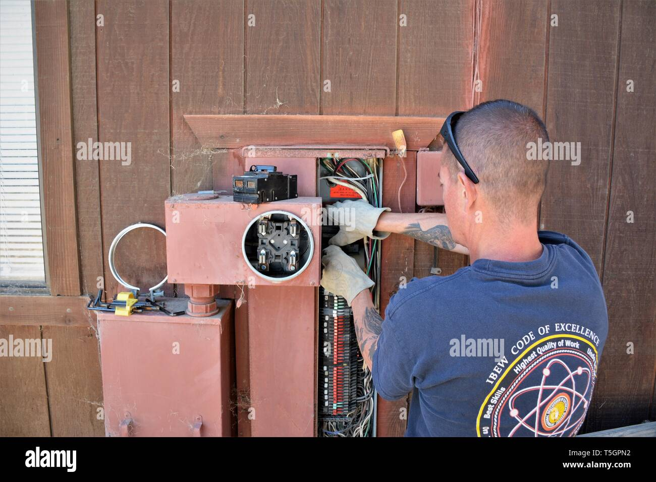 hight resolution of repairs being done to faulty wiring in older home by trained and certified electrical workers
