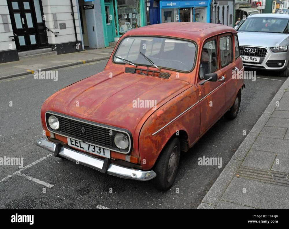 medium resolution of a battered and scruffy renault 4 classic car with peeling paint