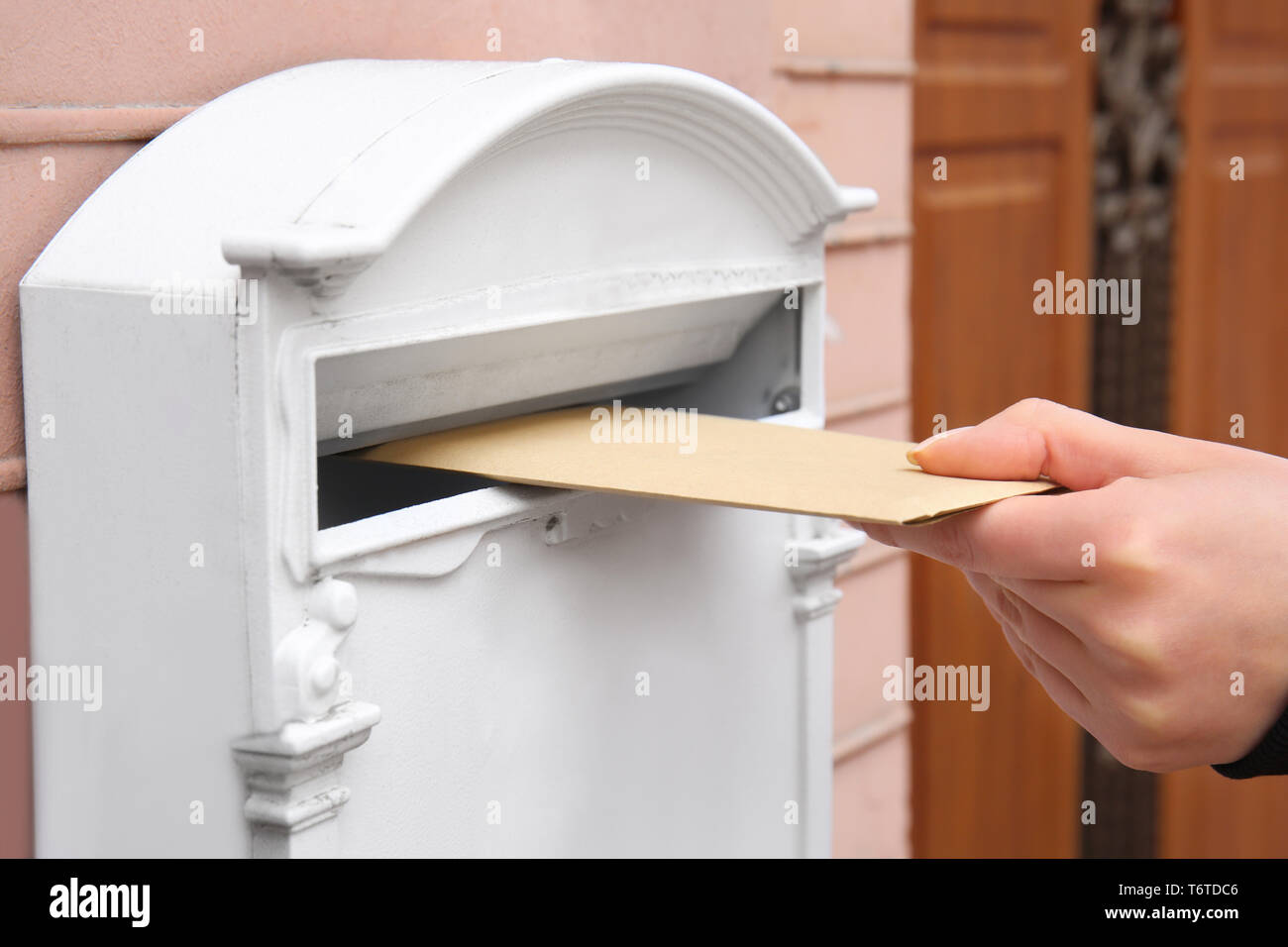 woman putting envelope into