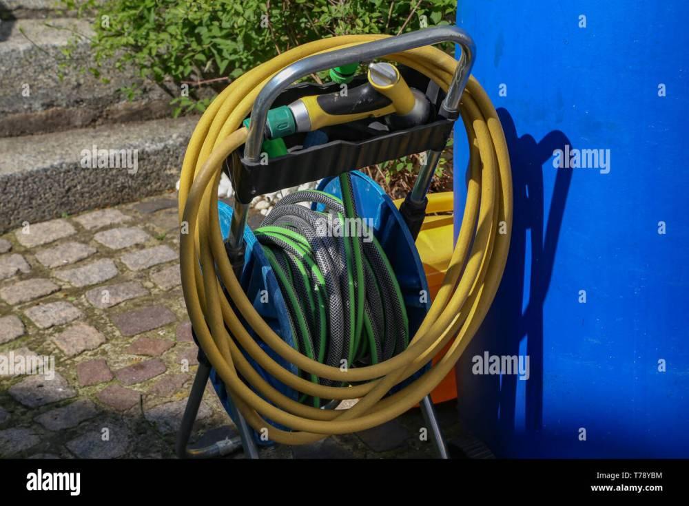medium resolution of bright watering garden hose near the house