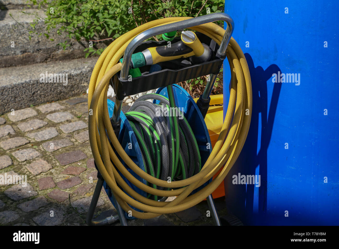 hight resolution of bright watering garden hose near the house