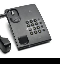 classic wired telephone used at home and in offices on a white isolated background lifted handset phone [ 1300 x 953 Pixel ]